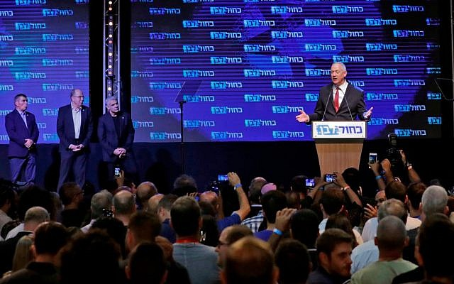 Benny Gantz (R), leader and candidate of the Israel Resilience party that is part of the Blue and White (Kahol Lavan) political alliance, addresses supporters at the alliance's campaign headquarters in the Israeli coastal city of Tel Aviv early on September 18, 2019, while flanked by other alliance leaders (L to R) independent Gabi Ashkenazi, Telem party's Moshe Yaalon, and Yesh Atid party's Yair Lapid. - Israeli Prime Minister Benjamin Netanyahu and his main challenger Benny Gantz were locked in a tight race in the country's general election after polls closed, exit surveys showed, raising the possibility of another deadlock. Three separate exit polls carried by Israeli television stations showed Netanyahu's right-wing Likud and Gantz's centrist Blue and White alliance with between 31 and 34 parliament seats each out of 120. Getty Images