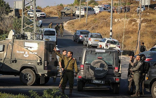 Israeli military and security forces search the area where an Israeli student, 19, was found stabbed to death in the West Bank. Aug. 8, 2019. (Gershon Elinson/Flash90/via JTA)