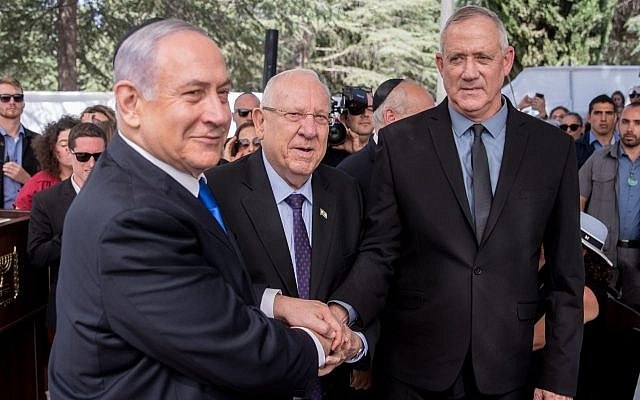 From left: Prime Minister Benjamin Netanyahu, President Reuven Rivlin, and Blue and White leader Benny Gantz, at the memorial ceremony for the late President Shimon Peres, at the Mount Herzl cemetery in Jerusalem, Sept. 19, 2019. (Yonatan Sindel/Flash90/via JTA)