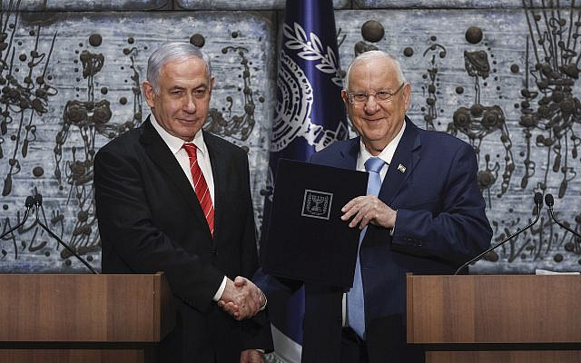 Israeli Prime Minister Benjamin Netanyahu, left, is presented with the mandate to form a new government by Israeli President Reuven Rivlin, at the President's Residence in Jerusalem Sept/ 25, 2019. (Yonatan Sindel/Flash90/via JTA)