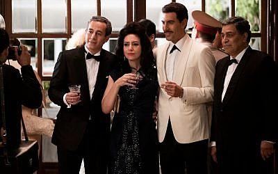 In a white suit, Sacha Baron Cohen as Israeli spy Eli Cohen. Courtesy of Axel Decis/Netflix