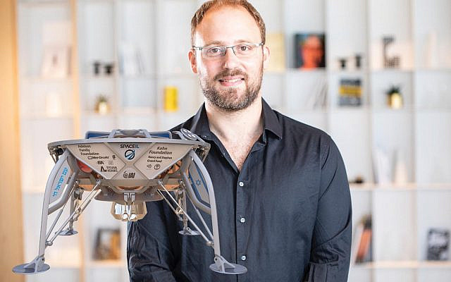 SpaceIL co-founder Kfir Damari and a model of its Beresheet lunar lander. Courtesy of Space IL