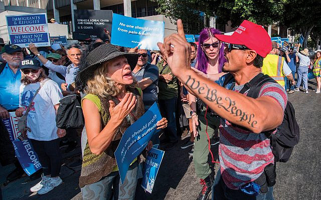 "Demonstrators at a ""Jews Say #CloseTheCamps"" protest clash with a supporter of President Trump in August in Los Angeles. Getty Images"
