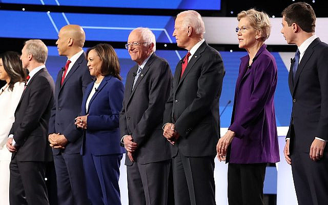 A record 12 Democratic presidential candidates stand before the start of their debate at Otterbein University in Westerville, Ohio, Oct. 15, 2019. (Chip Somodevilla/Getty Images/via JTA)