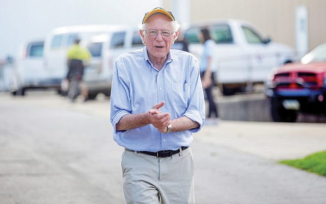 Bernie Sanders at a Fourth of July parade this summer in Pella, Iowa. Joshua Lott/Getty Images