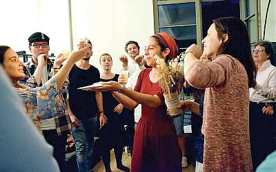 """Rabbi Rebecca Blady at a Havdalah service in 2017. She urges that Germany's Jews be counted """"in our global Jewish narrative."""" Courtesy of Base Berlin"""