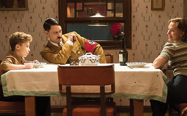 "Serious fun: Scene from the new black comedy ""Jojo Rabbit,"" starring Scarlett Johansson, Polynesian Jewish director Taika Waititi (as Hitler) and Roman Griffin Davis as Jojo. Fox Searchlight Pictures"