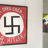 A Belgian politician presented this painting featuring a large swastika at the Bog-Art Gallery in Brussels. Courtesy of LBCA