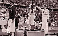 Helene Mayer, right, on the medal stand at the 1936 Summer Games in Berlin. Wikimedia Commons