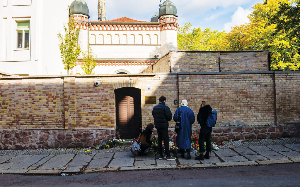 Visitors at the synagogue in Halle on Oct. 10, the day after a gunman targeted the house of worship in eastern Germany. Getty Images