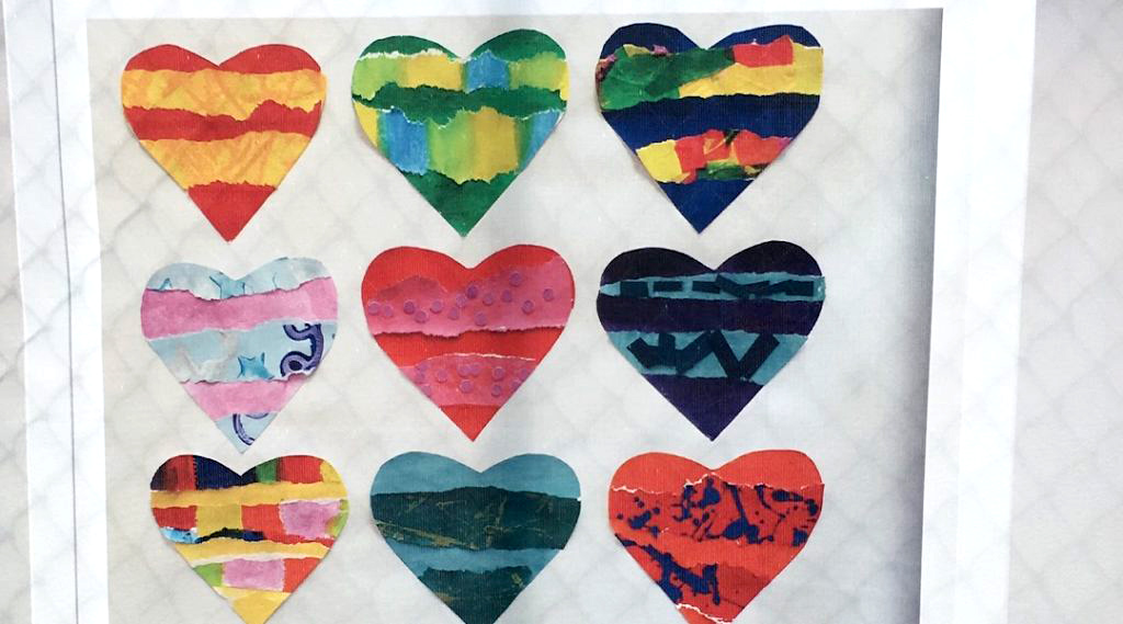 Artworks submitted by children from around the world, including from Columbine, Colorado; Newtown, Connecticut; and Parkland, Florida — all sites of mass shootings - frame the fence of Tree of Life. Beth Kissileff/JTA