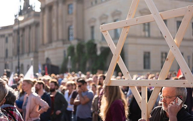 Thousands rally against anti-Semitism on Oct. 13, 2019 at Bebelplatz square in the center of Berlin, days after two people were killed by a gunman targeting a synagogue in the city of Halle. (Axel Schmidt/AFP via Getty Images/via JTA)