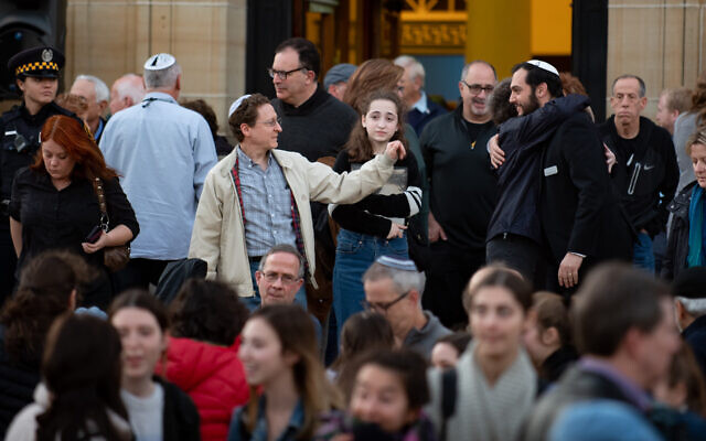 Participants at a memorial for the victims of the Pittsburgh synagogue shooting greet each other following the public service at the Soldiers and Sailors Memorial, Oct. 27, 2019. (Jeff Swensen/Getty Images)