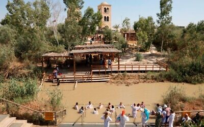 The Jordan River, holy to so many faiths. Here, Christian pilgrims are baptized at the baptismal site known as Qasr al-Yahud near the West Bank town of Jericho on September 13, 2019. Getty Images