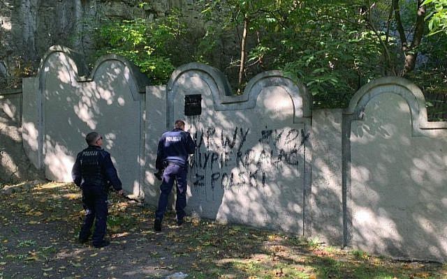 Vandals painted a swastika and other graffiti on one of the remaining walls of the former Krakow Ghetto on Oct. 1, 2019. (Courtesy of Jonathan Ornstein/via JTA)