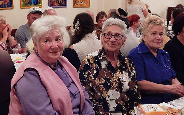 Elderly Jews attending the Rosh Hashanah dinner at Hesed Triaspol, Transnistria, in 2018. (Courtesy of JDC/via JTA)