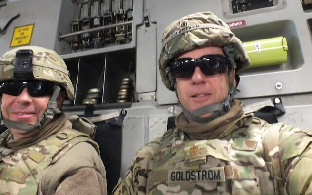 Goldstrom (right) with his chaplain assistant in Afghanistan, Sgt David Teakell, while riding to visit military personnel at other bases and outposts in 2013. (Courtesy of Goldstrom/via JTA)