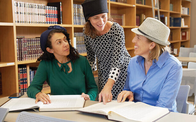 Michelle Farber, center, discussing a page of Talmud with two of her students, Lisa Kolodny, left, and Estie Agus. Ardon Bar-Hama