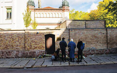 A makeshift memorial at the scene of the synagogue attack in Halle, Germany.  Getty Images