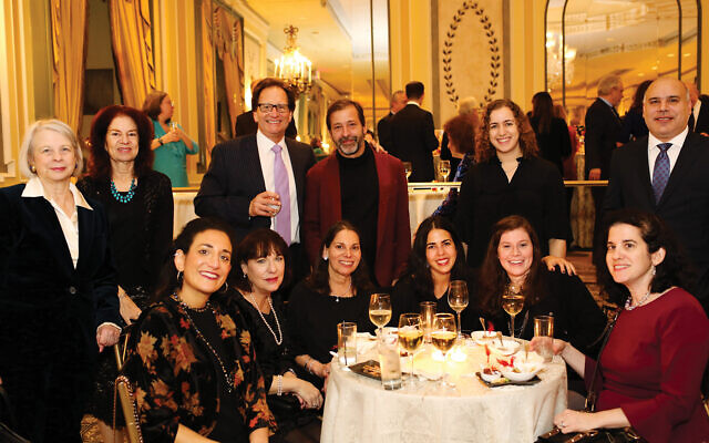 Publisher Richard Waloff, top row, third from left, with colleagues at The Jewish Week's gala, Nov. 13, 2019