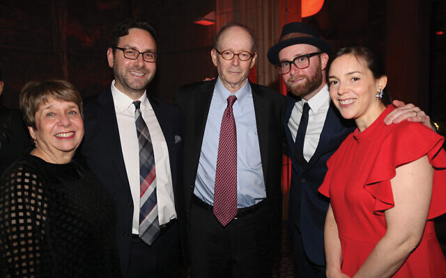 Gary Rosenblatt, center, at last week's gala marking his retirement as editor and publisher of the paper. With him are his wife, Judy Rosenblatt, and his three children, from left, Avi and Dov Rosenblatt, and Tali Rosenblatt Cohen. Courtesy of Nomi Ellenson