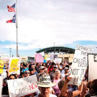 A July protest against U.S. immigration policy in El Paso, Texas. Some have called the policy, crafted largely by White House senior adviser Stephen Miller, as cruel and inhumane. Getty Images