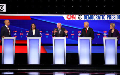 Sen. Cory Booker (D-NJ), Sen. Kamala Harris (D-CA), Sen. Bernie Sanders (I-VT), former Vice President Joe Biden, and Sen. Elizabeth Warren (D-MA)  interact during the Democratic Presidential Debate at Otterbein University on October 15, 2019 in Westerville, Ohio. Getty Images