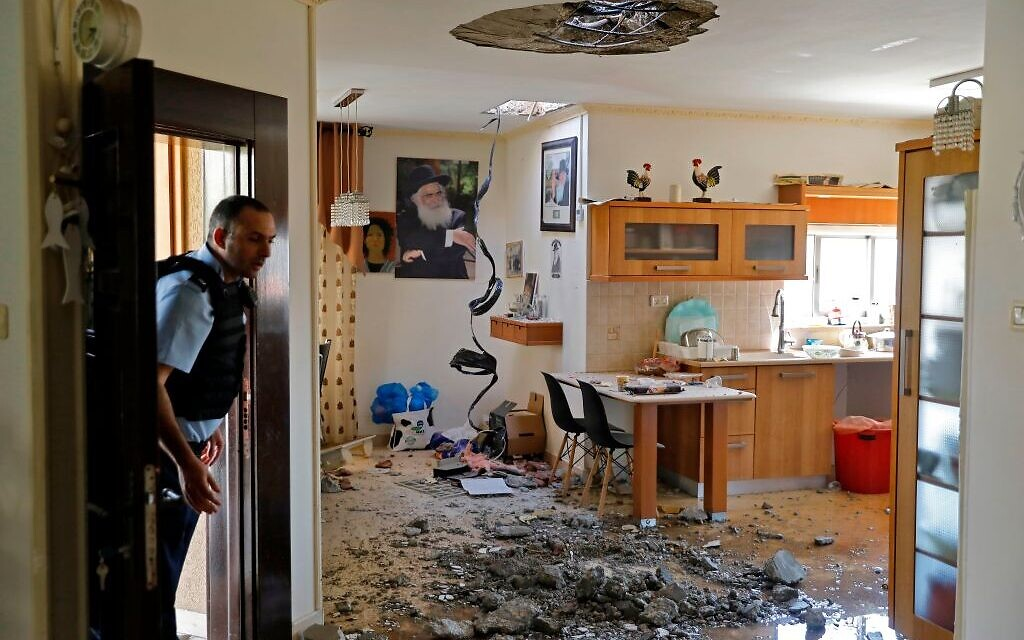 An Israeli policeman inspects the damage inside a house in the southern Israeli town of Netivot on November 12, 2019, following a rocket attack from Gaza City in retaliation to the Israeli strike that killed a commander of Palestinian militant group Islamic Jihad. - Israel's military killed a commander of Palestinian militant group Islamic Jihad in a strike on his home in the Gaza Strip early, prompting retaliatory rocket fire and fears of a severe escalation in violence. Getty Images