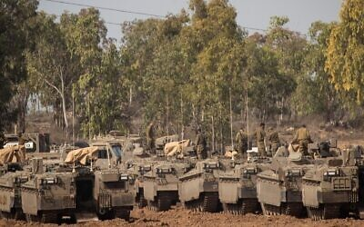 Israeli soldiers at a staging area in southern Israel, near the border with the Gaza Strip, Nov. 13, 2019. A cease-fire between Israel and Gaza terror groups went into effect on the following morning after 450 rockets were fired from Gaza into Israel in the wake of Israel's assassination of a terror leader. JTA