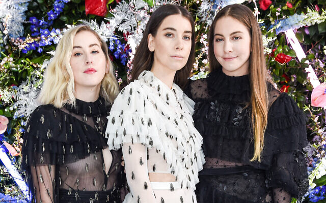 The Haim sisters, from left, Alana, Danielle and Este, of the group Haim at Rodarte's fashion week show in San Marino, Calif., Feb. 5, 2019. (Presley Ann/Patrick McMullan via Getty Images/via JTA)