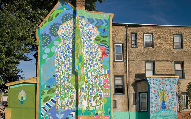 """Shira Walinsky's """"World Tree"""" is part of the mural program run by Jane Golden, right. World Tree credit: Jack Ramsdale/Mural Arts"""