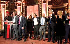 Rabbi Elliot Cosgrove and Cantor Azi Schwartz led members of Park Avenue Synagogue in song at the end of a ceremony Sunday celebrating a six-year fundraising and building campaign. Cardinal Timothy M. Dolan, the archbishop of New York, is at far left. JW Staff