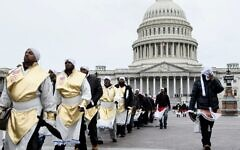 Members of the Black Hebrew Israelites walk from Capitol Hill in Washington, D.C., Nov. 13, 2018. (Brendan Smialowski/AFP via Getty Images/via JTA)