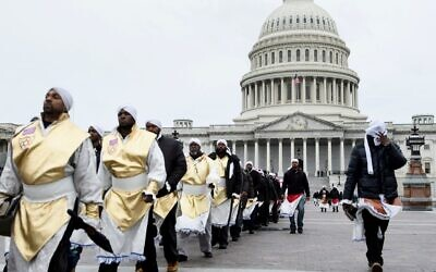 Members of the Black Hebrew Israelites walk from Capitol Hill in Washington, D.C., Nov. 13, 2018. (Brendan Smialowski/AFP via Getty Images/via JTA)