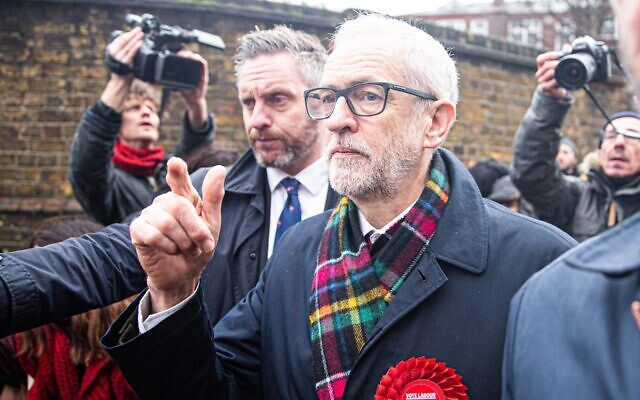 Britain's opposition Labour Party Leader Jeremy Corbyn  leaves a polling station after voting in the general elections in London, United Kingdom, on 12 December 2019. Getty Images