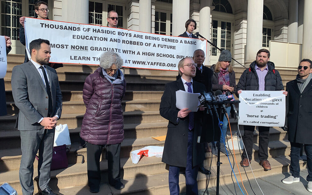 Yaffed's Naftali Moster speaking Monday at City Hall surrounded by some of his supporters. Former Manhattan Borough President Ruth Messinger is at left. Shira Hanau/JW