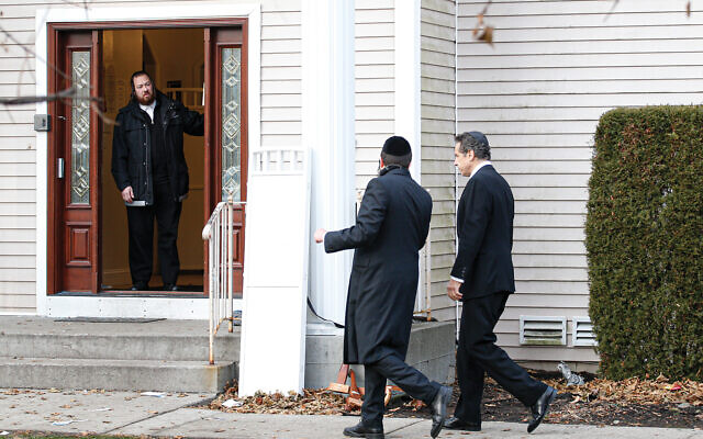 Gov. Andrew Cuomo approaching the home of Rabbi Chaim Rottenberg, site of the machete attack on Chanukah that injured five chasidic Jews. The Monsey community is on edge. Getty Images