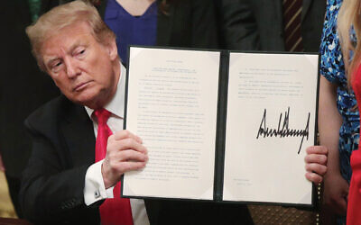President Trump at the recent signing ceremony for an executive order extending protections for Jewish college students under Title VI of the Civil Rights Act. The order touched off a heated debate in the Jewish community. Getty Images
