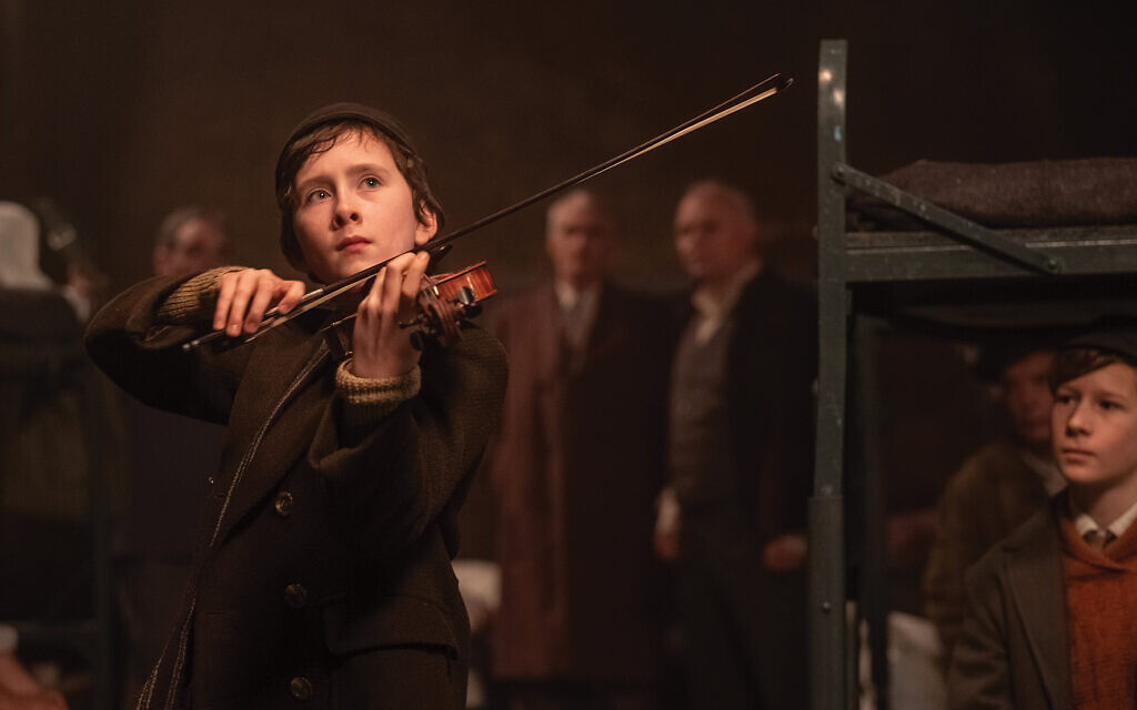 Strings attached through the years: Child prodigy violinist Dovidl Rapaport as played by Luke Doyle,. Photo by Sabrina Lantos/Courtesy of Sony Pictures Classics
