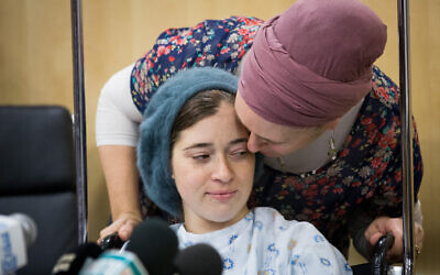 Shira and Amichai Ish Ran hold a news conference at the Shaarei Tzedek hospital a week after being injured in a West Bank terror attack, Dec. 16, 2018. (Yonatan Sindel/Flash 90/via JTA)