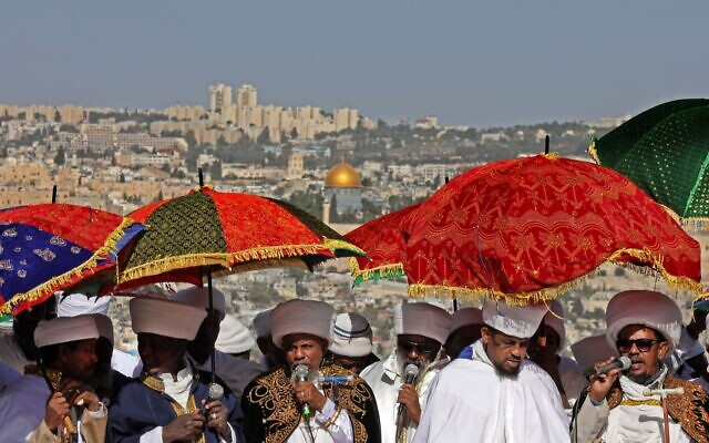 "Israeli 'Kessim' or religious leaders of the Ethiopian Jewish community lead the prayers during the Sigd holiday marking the desire to ""return to Jerusalem"", as they celebrate from a hilltop in the holy city, on November 27, 2019. GALI TIBBON/AFP via Getty Images."