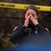 A Jersey City police officer reacts at the scene of a shooting that left multiple people dead on December 10, 2019 in Jersey City, New Jersey. In a raging gun battle that by some accounts lasted in excess of an hour, six people - a Jersey City police officer, three civilians and two suspects - were killed in the Tuesday afternoon standoff and shootout across the Hudson River from Manhattan, according to published reports. Getty Images