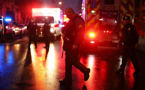 Emergency personnel are shown on the scene of a shooting that left multiple people dead on December 10, 2019 in Jersey City, New Jersey. In a raging gun battle that by some accounts lasted in excess of an hour, six people - a Jersey City police officer, three civilians and two suspects - were killed in the Tuesday afternoon standoff and shootout across the Hudson River from Manhattan, according to published reports. Getty Images