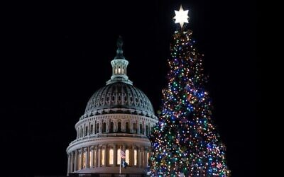 The US Capitol Christmas Tree and Capitol Dome are seen during the annual U.S. Capitol Christmas Tree Lighting Ceremony on the West Front Lawn of the US Capitol on December 4, 2019 in Washington, DC. Sarah Silbiger/Getty Images