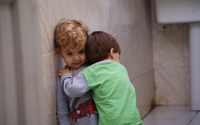 Illustrative image of kids embracing. Pxhere