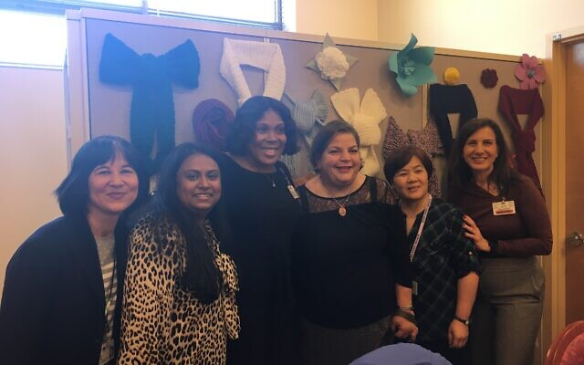 Jackie Belfiore (third from right) created a yarn drive for Parker on Madison. She stands with, from left, Amy Hsu, Rafeena Rahmaan-Ally, Trishanne Denhart and Gwak Eun Kyuns, from Parker on Madison, and Lina Scacco, from Parker Jewish Institute.