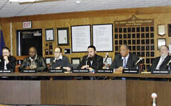 A meeting of the East Ramapo school board, which is controlled by a majority of Orthodox Jews. The NAACP suit alleges voting rights violations.