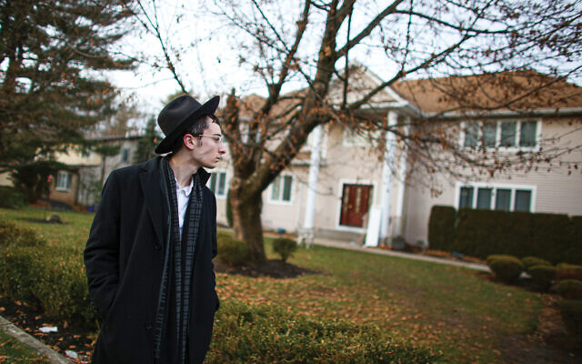 Scene of the crime: A chasidic man stands in front of the Monsey home of Rabbi Chaim Rottenberg, where a machete-wielding man injured five in an attack Saturday night. Getty Images