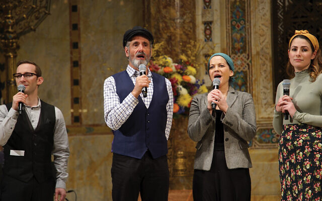 "Steven Skybell, center, as Tevye, and cast of the Yiddish ""Fiddler"" at Temple Emanu-El.  Courtesy of Streicker Center"