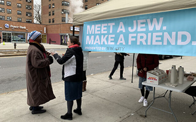"The organization Jew in the City set up shop on East 106th Street Monday. ""When you meet everyday people, I think that's where the shared commonalities come out,"" says the group's leader, Allison Josephs.  Shira Hanau/JW"